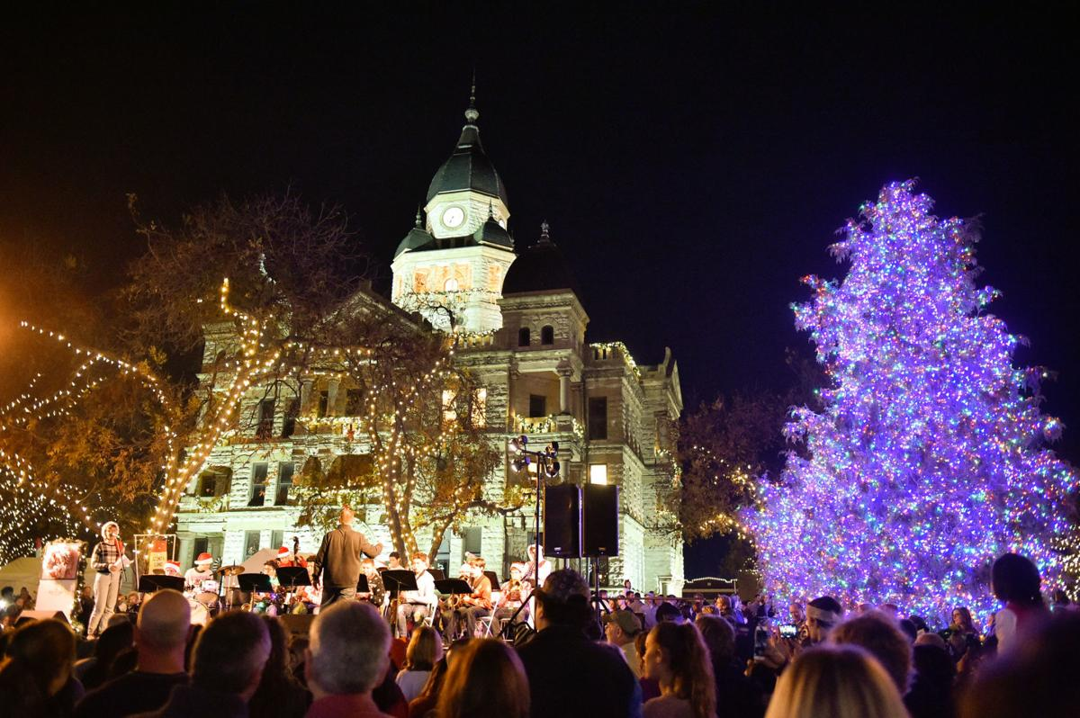 The crowd enjoys a orchestra concert during the Holiday Lighting Festival at the Courthouse-on-the-Square.The free festival is held annually and this will be the 29th time it has been held.  Guests enjoyed many fun activities such as watching concerts, s