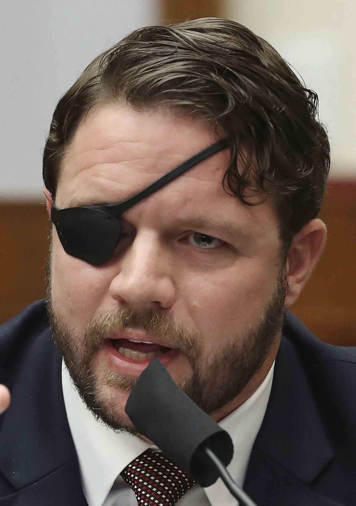 Rep. Dan Crenshaw undergoes emergency surgery on his remaining eye, 'terrifying prognosis' for ex-Navy SEAL
