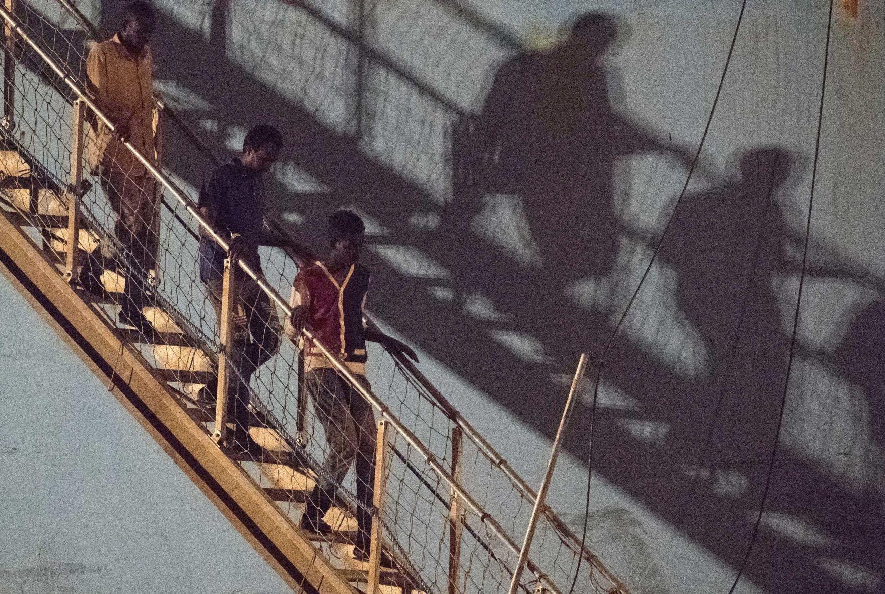 On both sides of Atlantic migrants meet