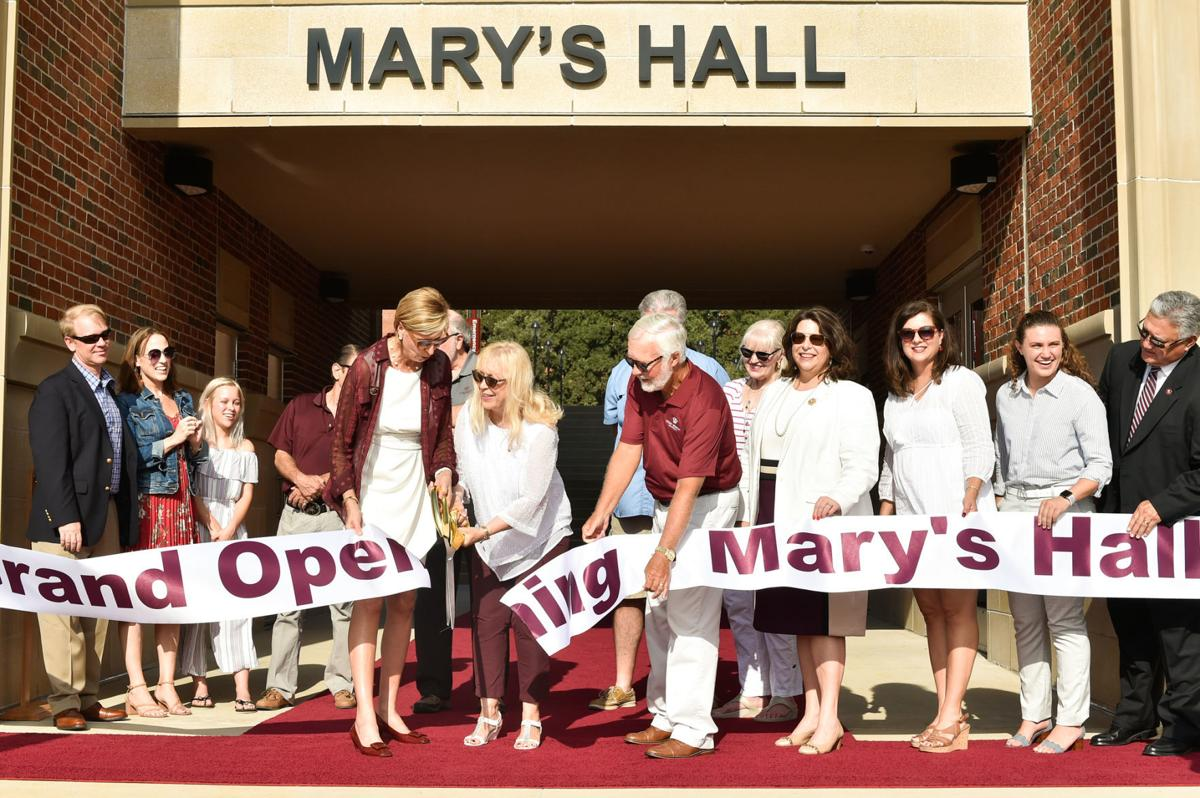 Cutting the ribbon on Mary's Hall