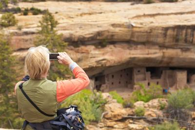 Tourist Photographing Scenery at Mesa Verde National Park