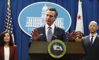 Newsom signs bill removing 'alien' from California code
