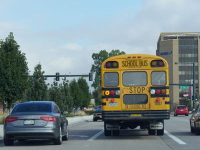 a public schools bus on the road in Denver