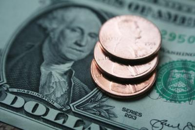 Minimum Wage With Dollar & Pennies High Quality Stock Photo