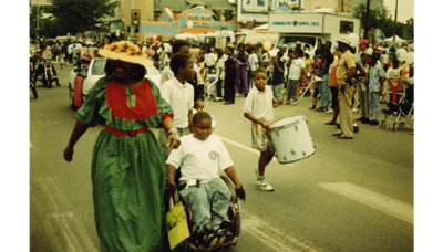 Woman with children in Juneteenth Parade