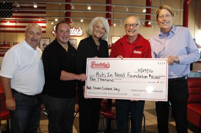 Freddy's makes donation to educational group