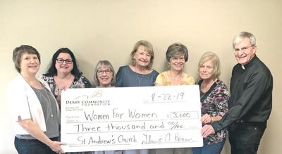 DCF presents check to St. Andrew's church