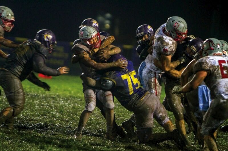 mitchell and other sabers combining for tackle.jpg