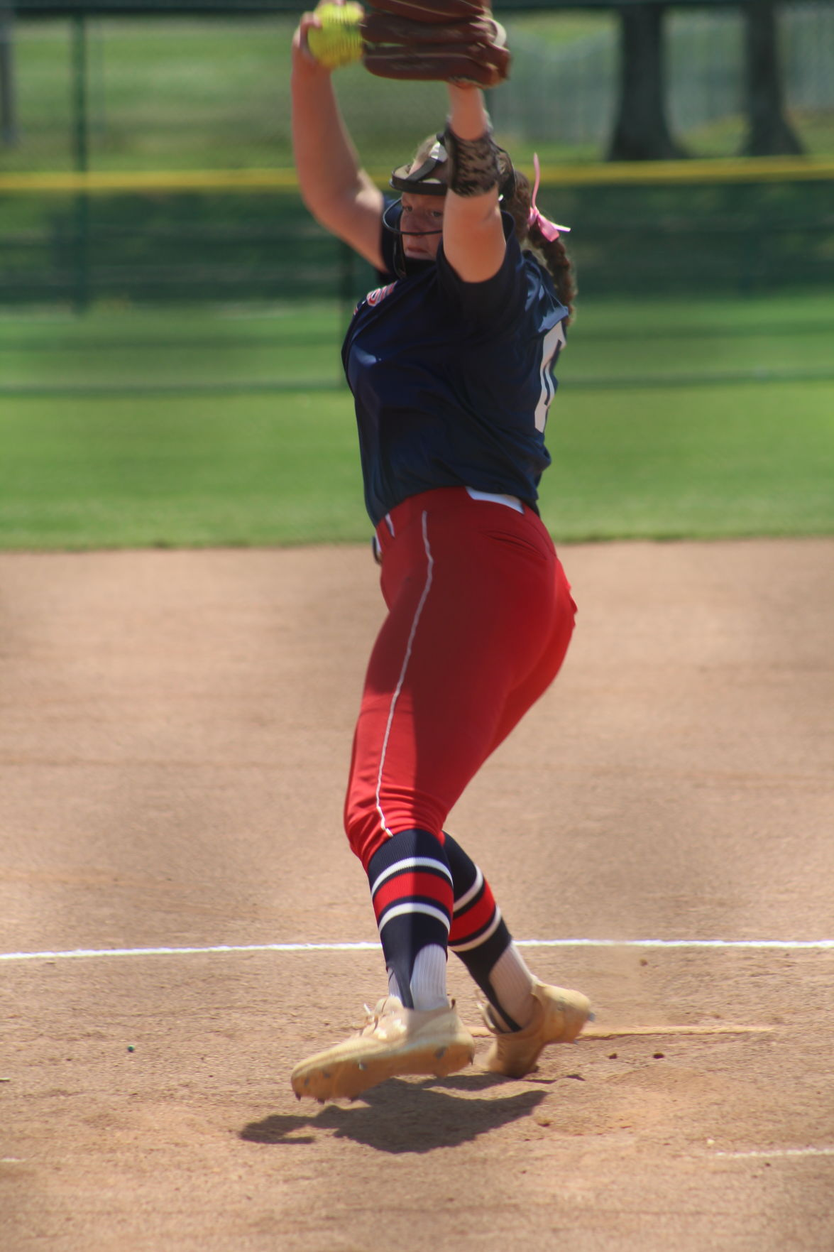 Creek Wood's Lennon Spicer fires a pitch.JPG