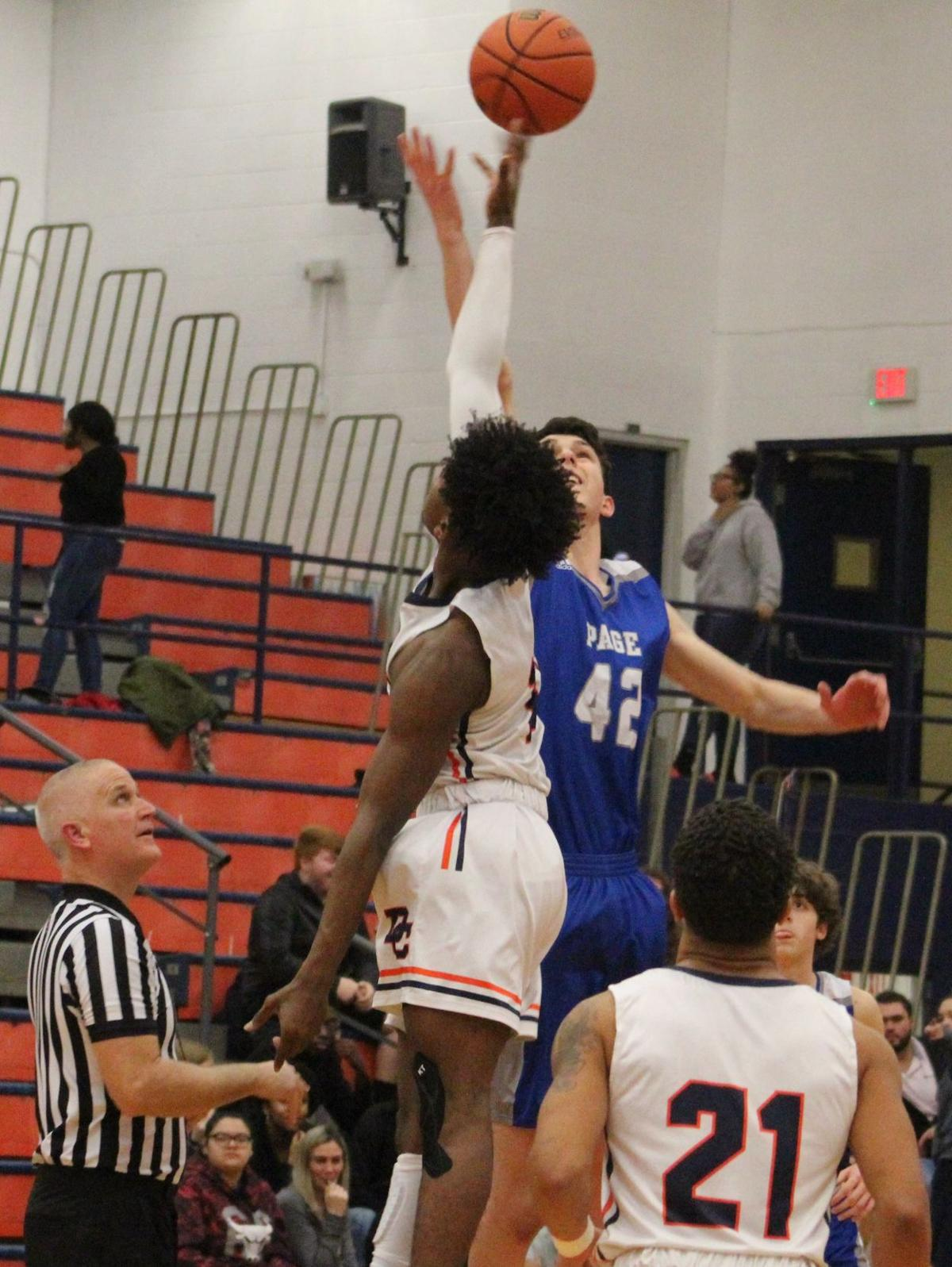 Jaden Davis goes up high to win the tip for Dickson County (Picture by Cameron Klotz).JPG