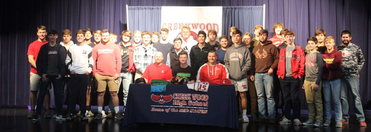 Houston Kilpatrick signs with his teammates from the baseball team.JPG