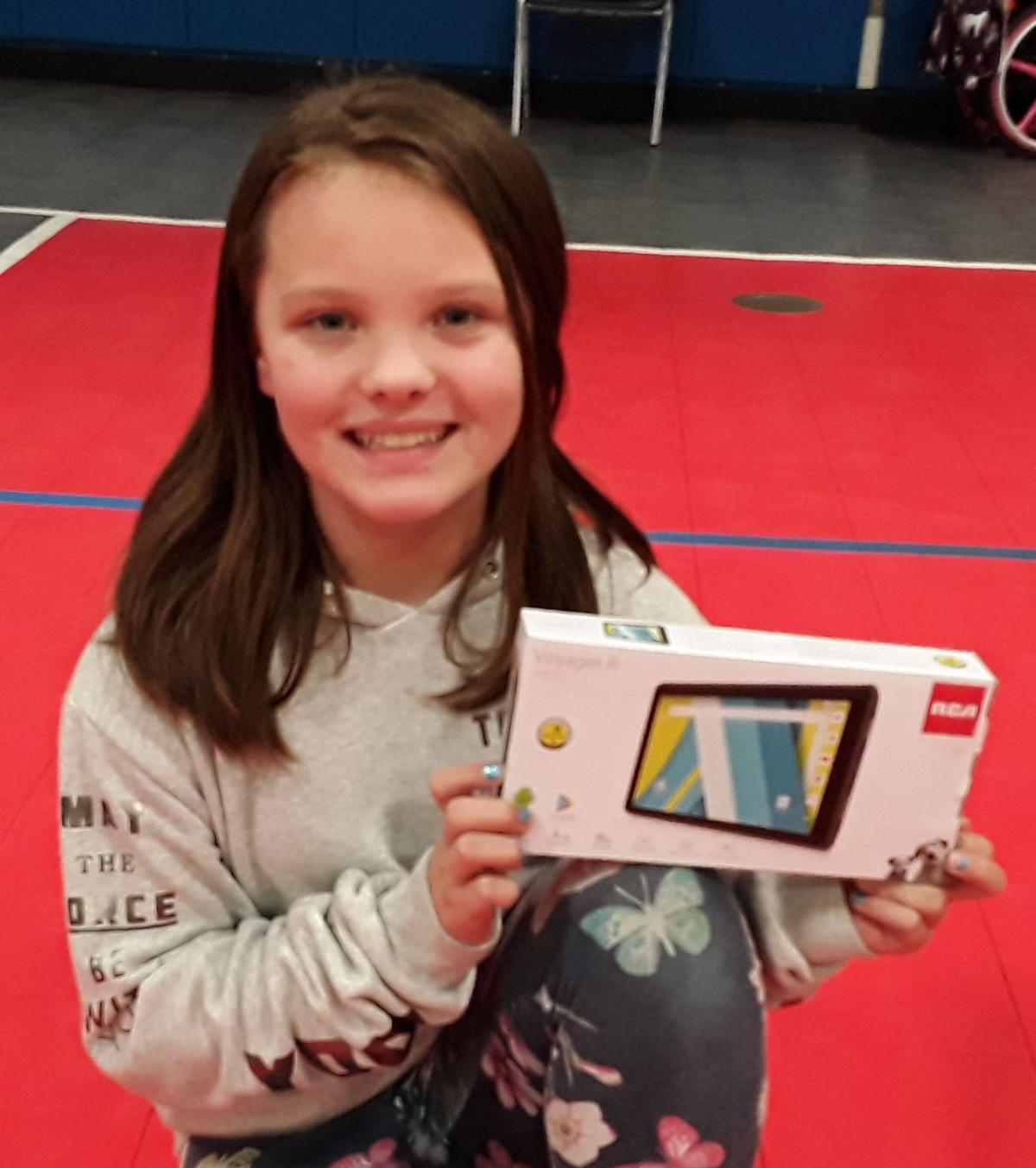 Leah Quirk wins a tablet.jpg