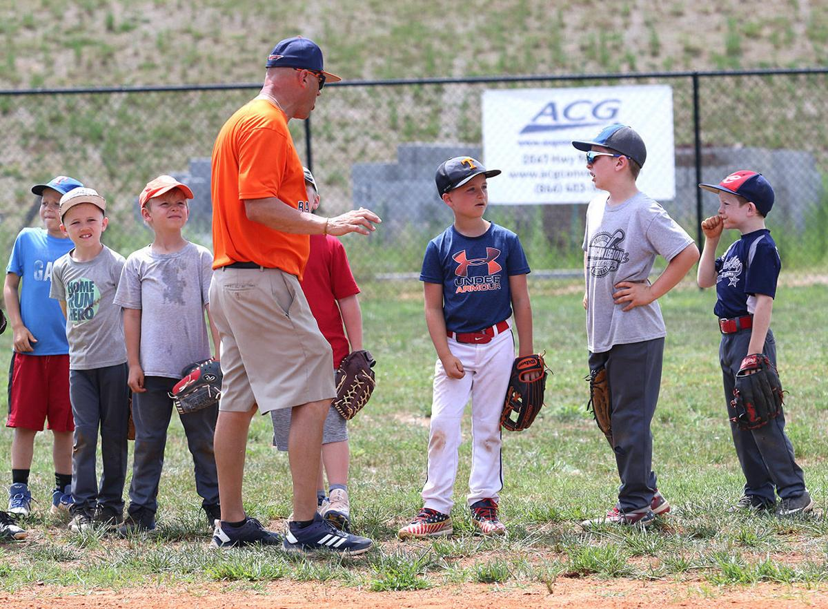 Campers receive some instructions at the Burns Baseball Skills & Development Camp. Marty Allison/Dickson Sports Media
