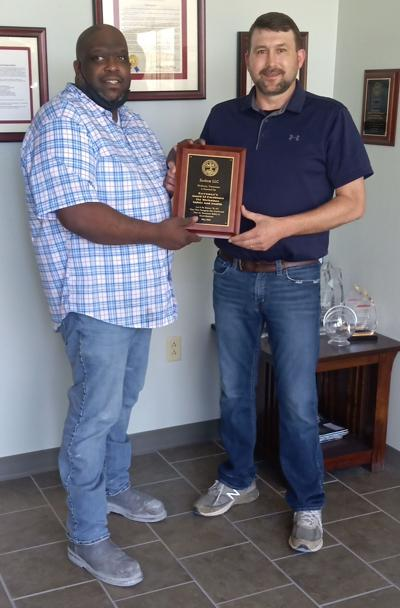 -(left to right) Chauncey Reed, Zochem's production manager, and Jimmy Kight, Zochem's plant manager hold the 2021 award plaque from Governor Bill Lee.