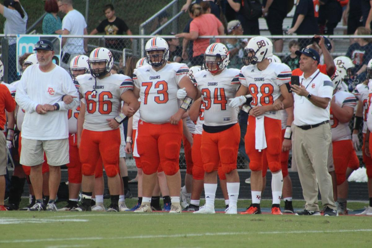 Dickson's Jay Powlas and Joey Holley stand with four Cougar players before the coin toss.JPG
