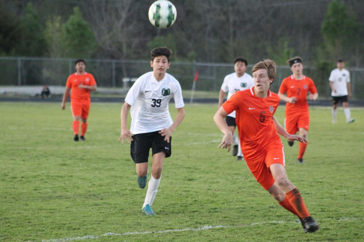 Tucker Purvine (5) goes after the ball as Fed Solis (39) chases.JPG