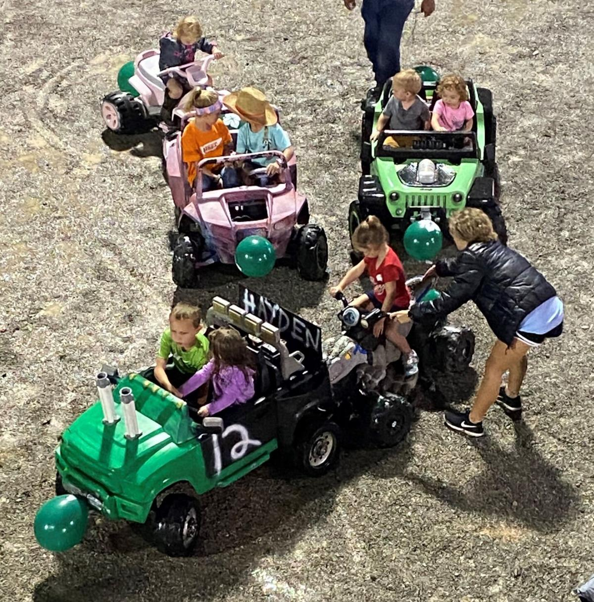 Grownups helped to clear tangled traffic during the Kids Power Wheels Derby on Saturday at the 96th Annual Dickson County Fair.