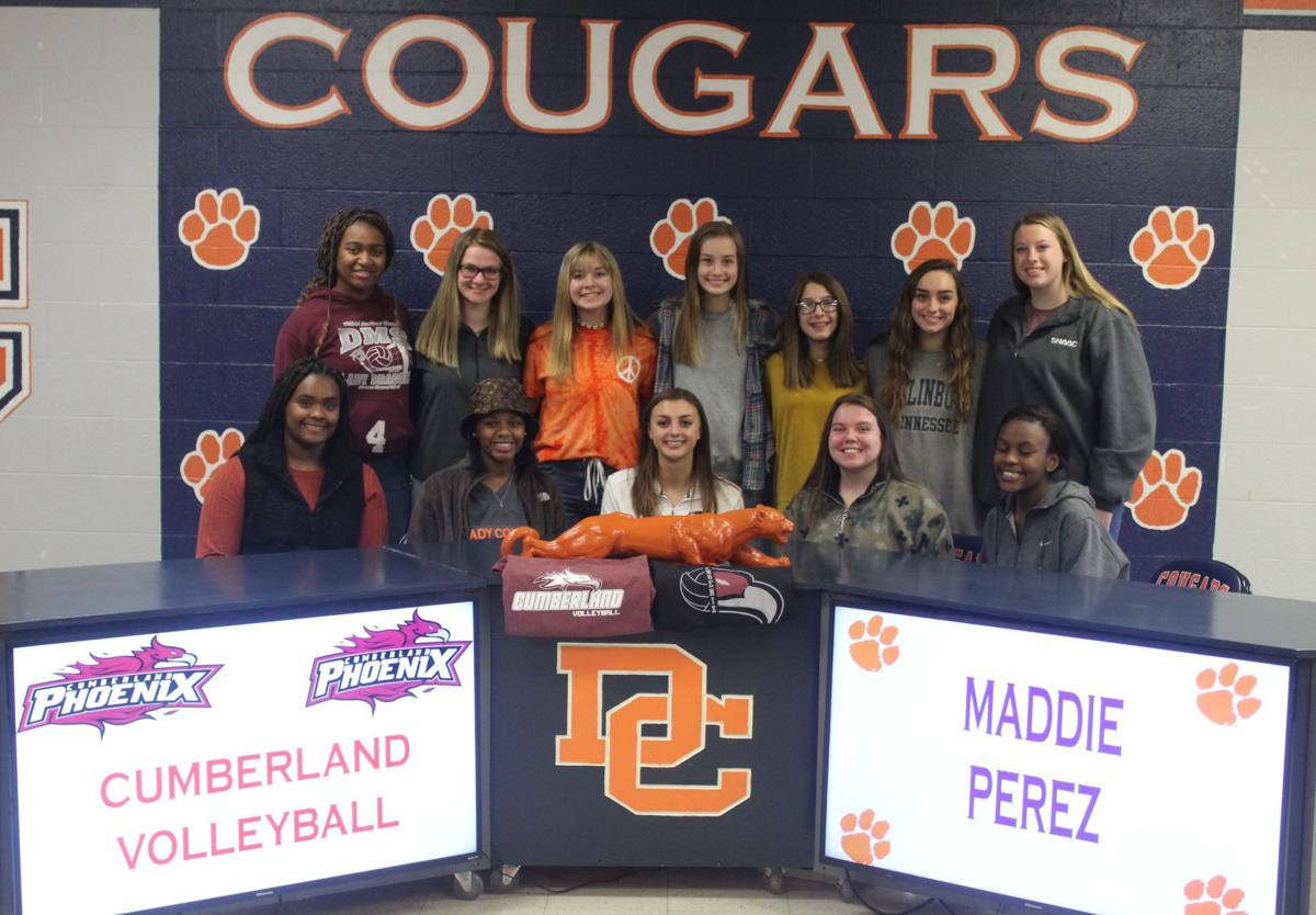 Maddie Perez signs with her teammates.JPG