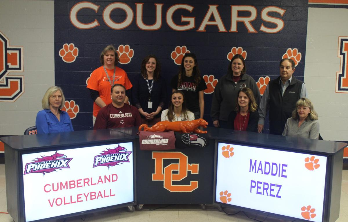 Maddie Perez signs with her family and coaches.JPG