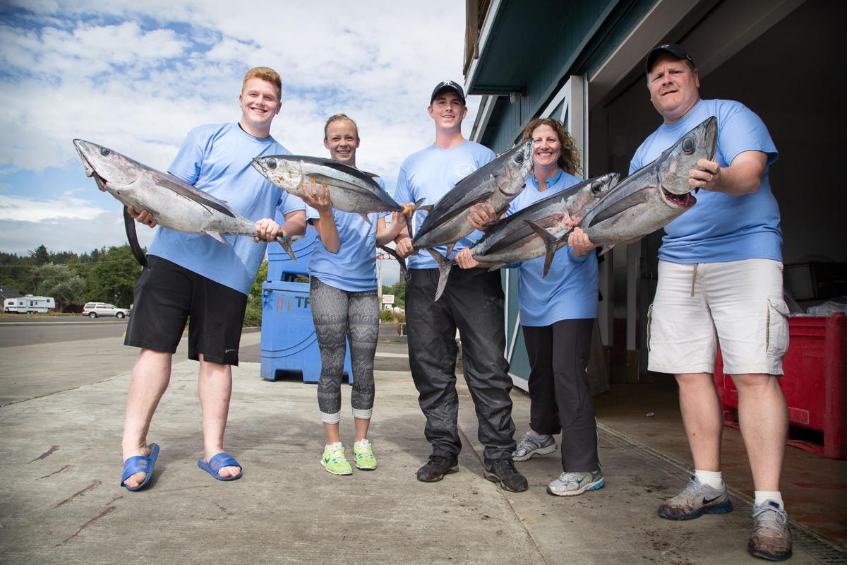 Customers pose with their catch
