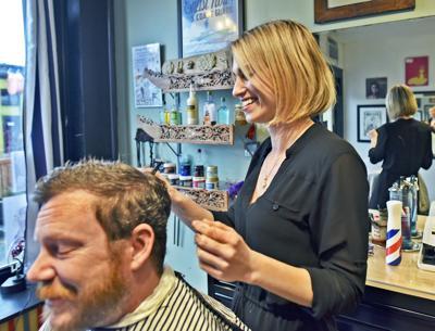 Sarah Jane Bardy cuts Ryan Hume's hair
