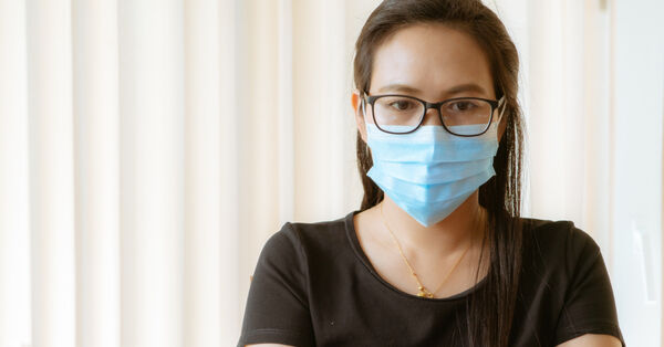 woman_with_face_mask_protection_while_working_for_protection_from_coronavirus_5e455aa18b374