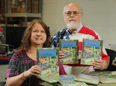 LOCAL FOLKS: Couple on mission to give away copies of co-authored book