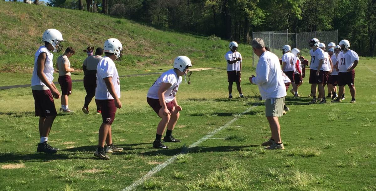 Coach Todd Lott and linemen