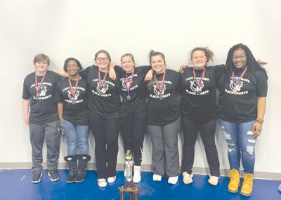 South Pontotoc Girls Powerlifting Team with Trophy