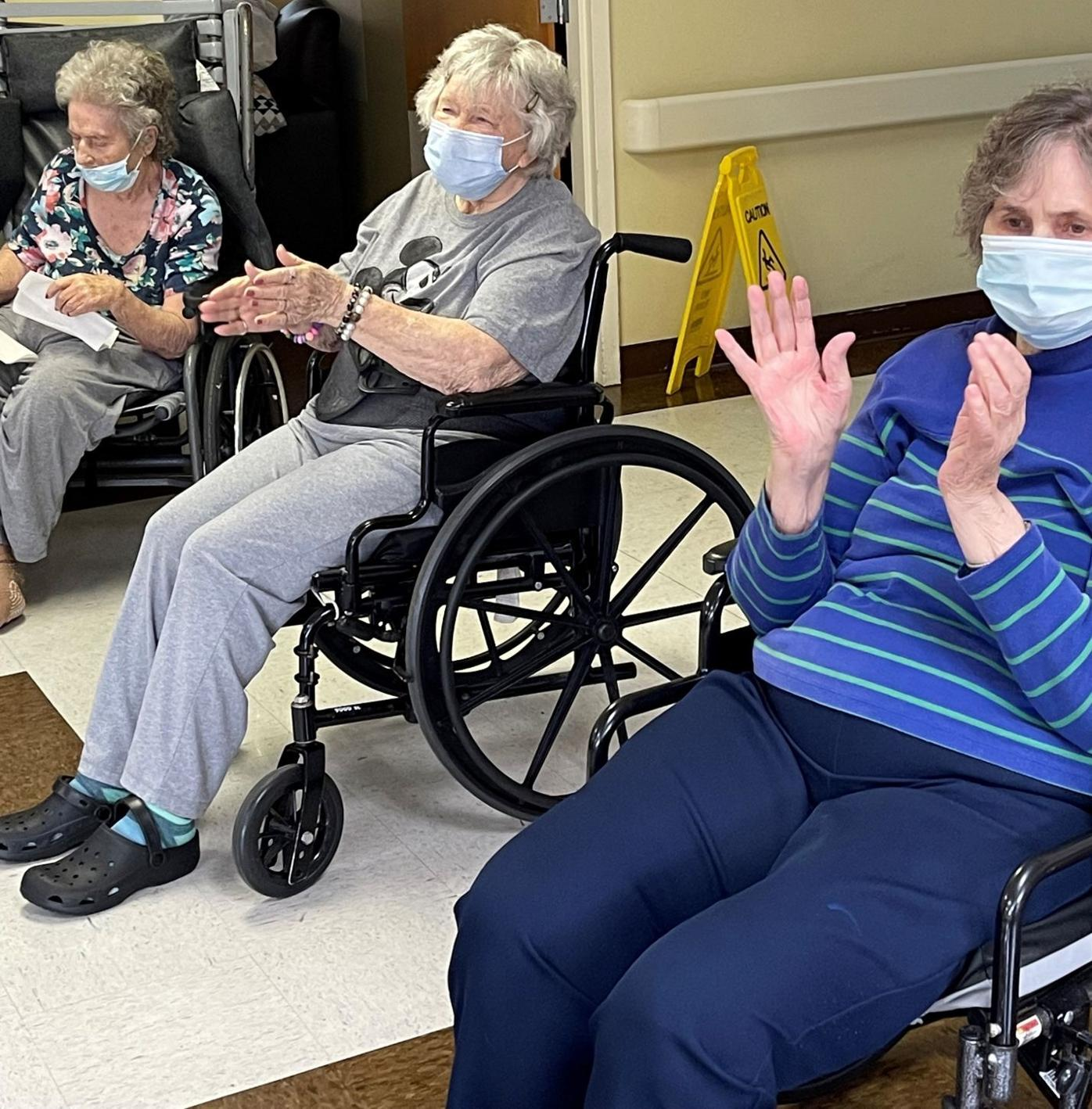 Lyna Branch, Mable Taylor, and Bonnie Hutchins participate in morning music and exercise..jpg