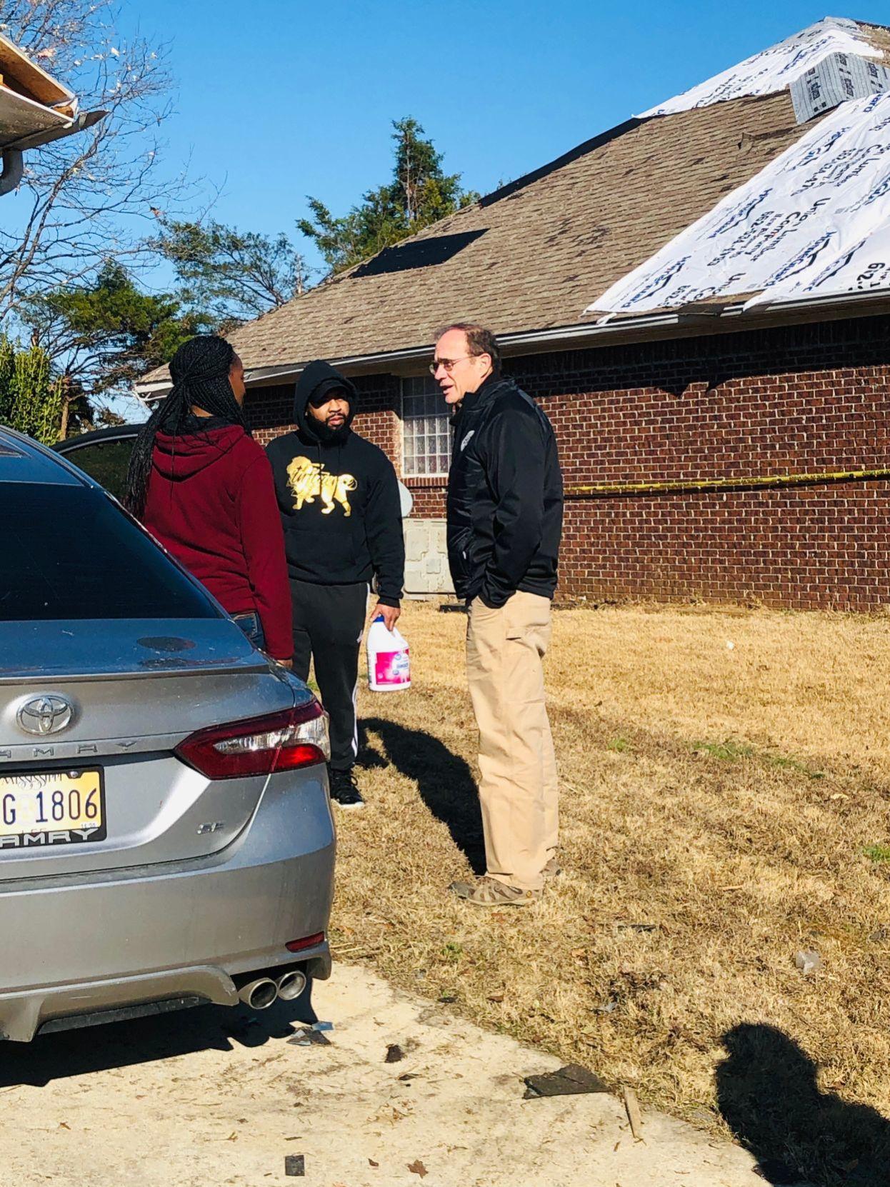 Delbert Hosemann visits with homeowners in Guntown