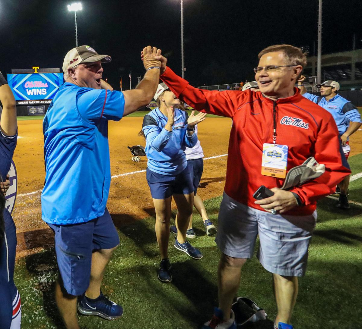 Ole Miss coach Mike Smith, chancellor Jeff Vitter