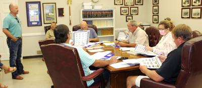 Equipment salesman talks to supervisors