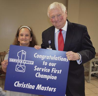 BMH CEO and Administrator Walter Grace presents the award to Christina Masters.