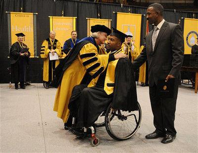 Paralyzed USM player gets ovation as he graduates