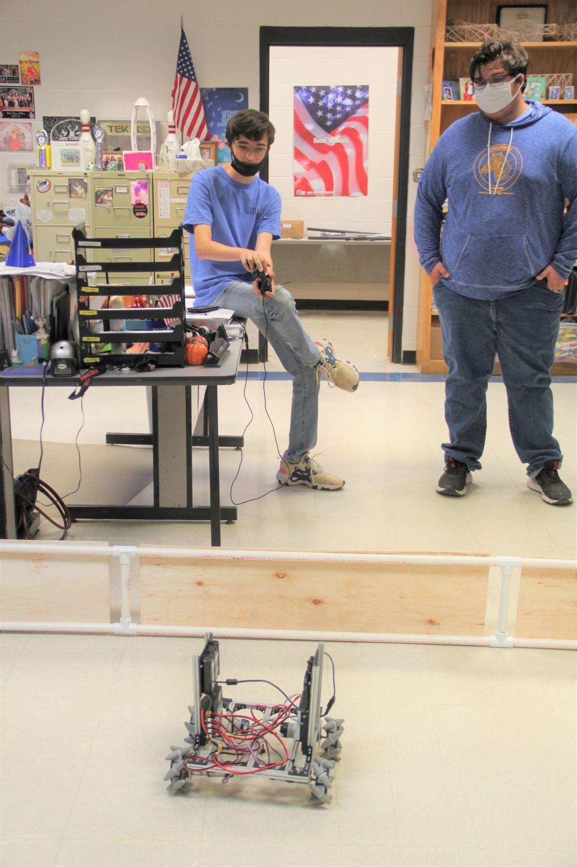 Caleb Murrell with Robot