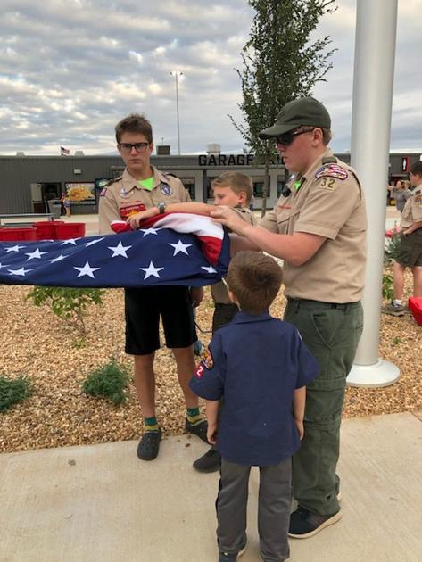 Fulton Scouts raise flag at Talladega
