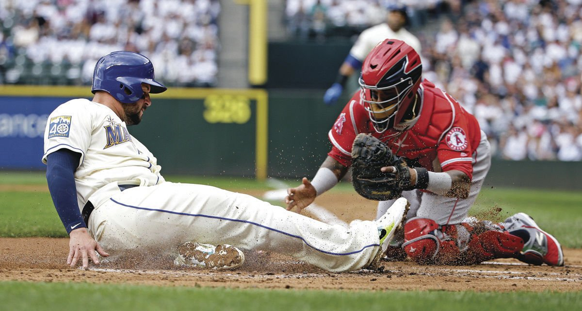 Mariners lose again on Angels' late runs