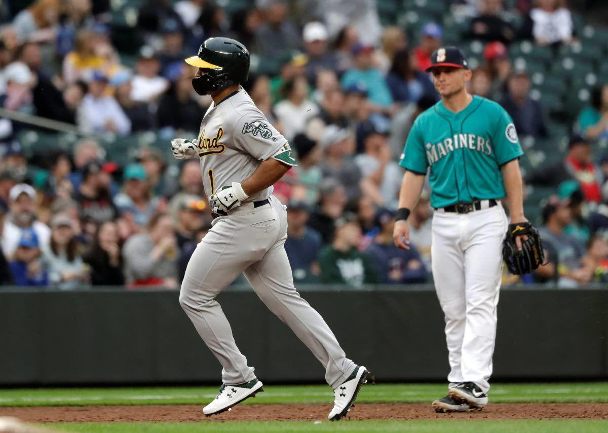 Athletics use late offensive surge to beat Mariners at home 5-2