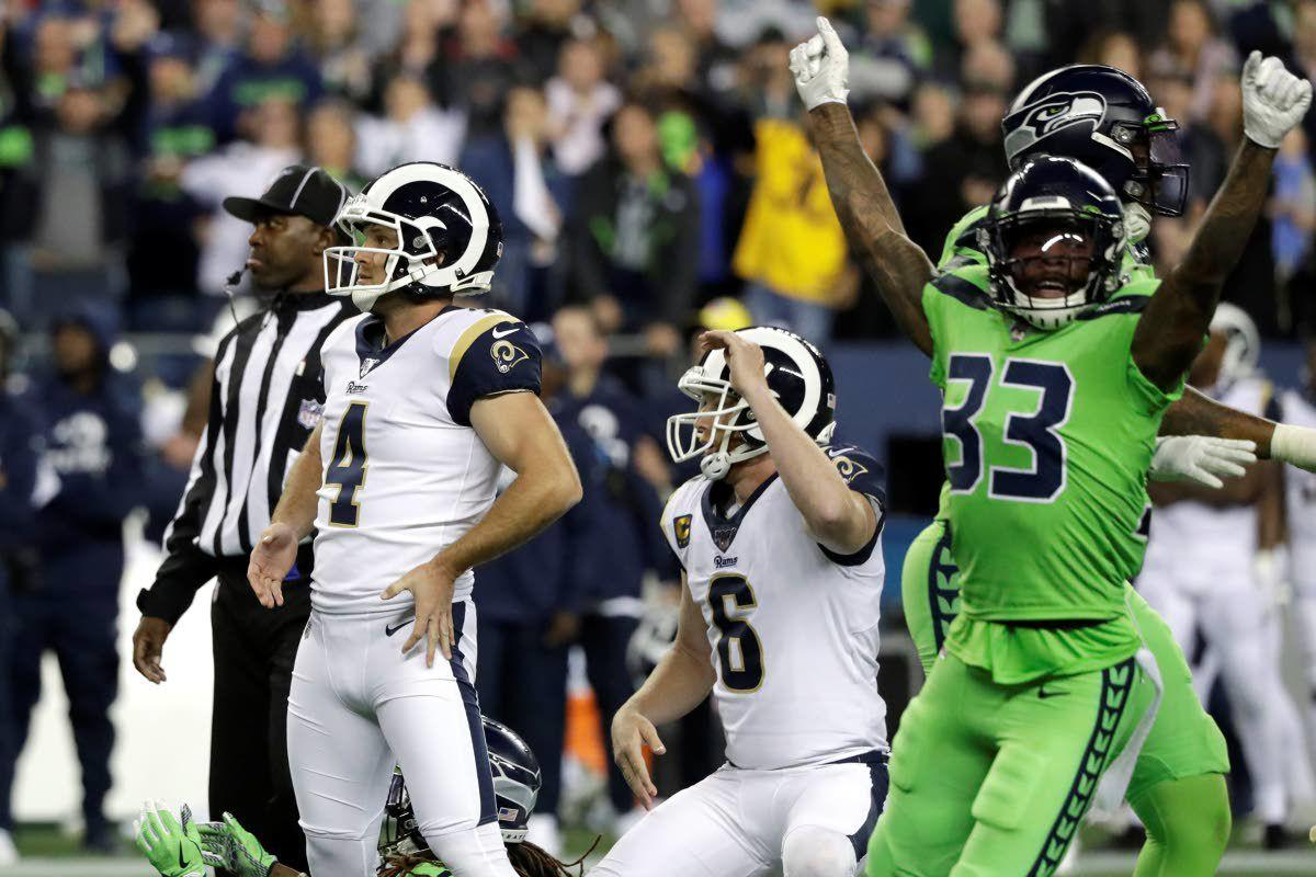 Wilson throws 4 TD passes in Seattle win