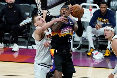 Resurgent Paul leads Suns past Nuggets