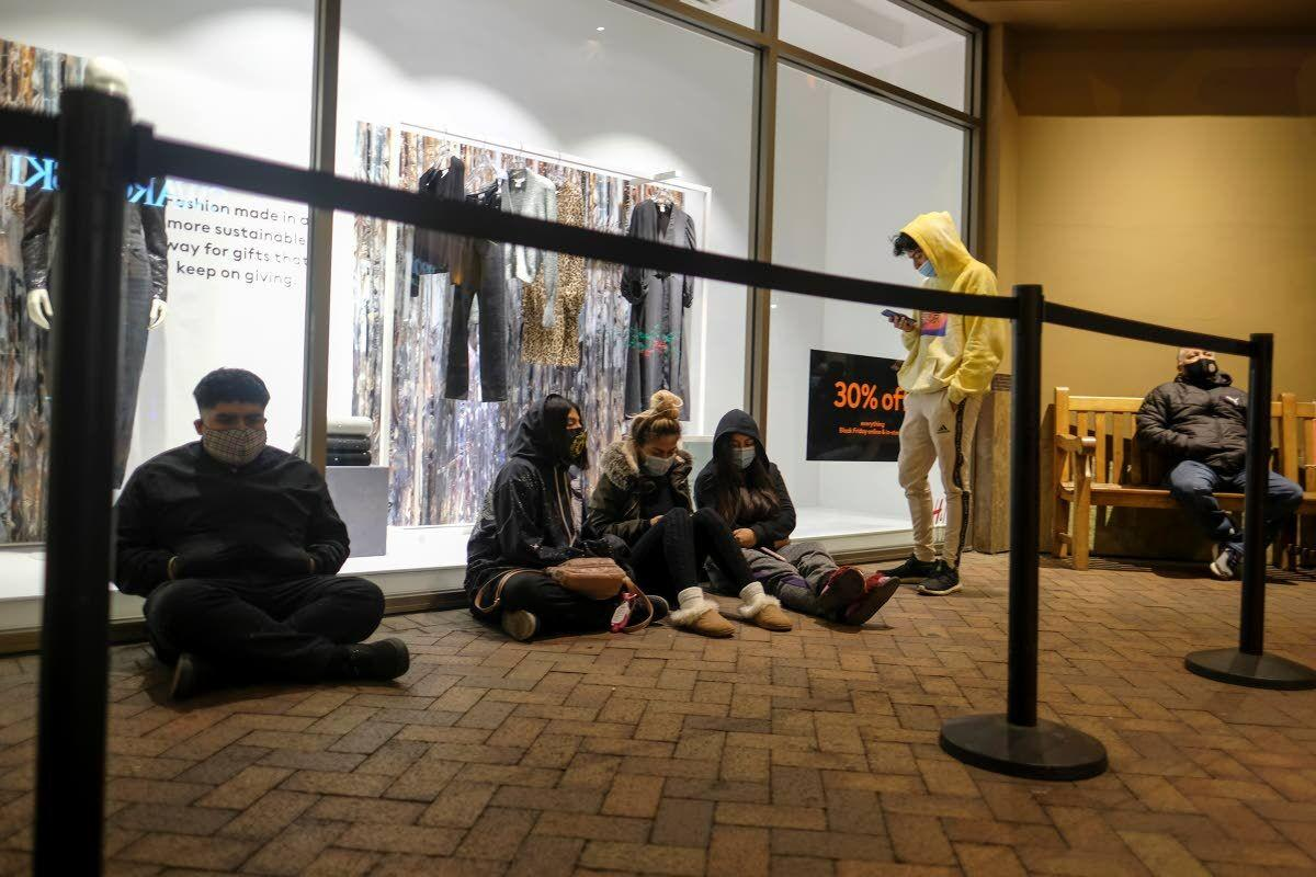 Virus keeps Black Friday crowds thin