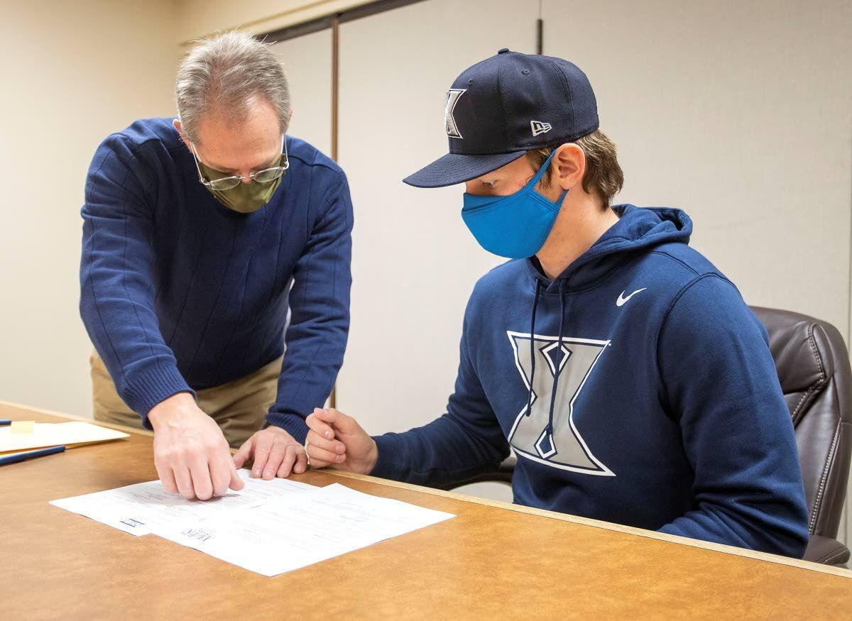 A golden arm signs with Xavier