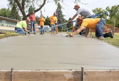 Photo: Smoothing a new sidewalk