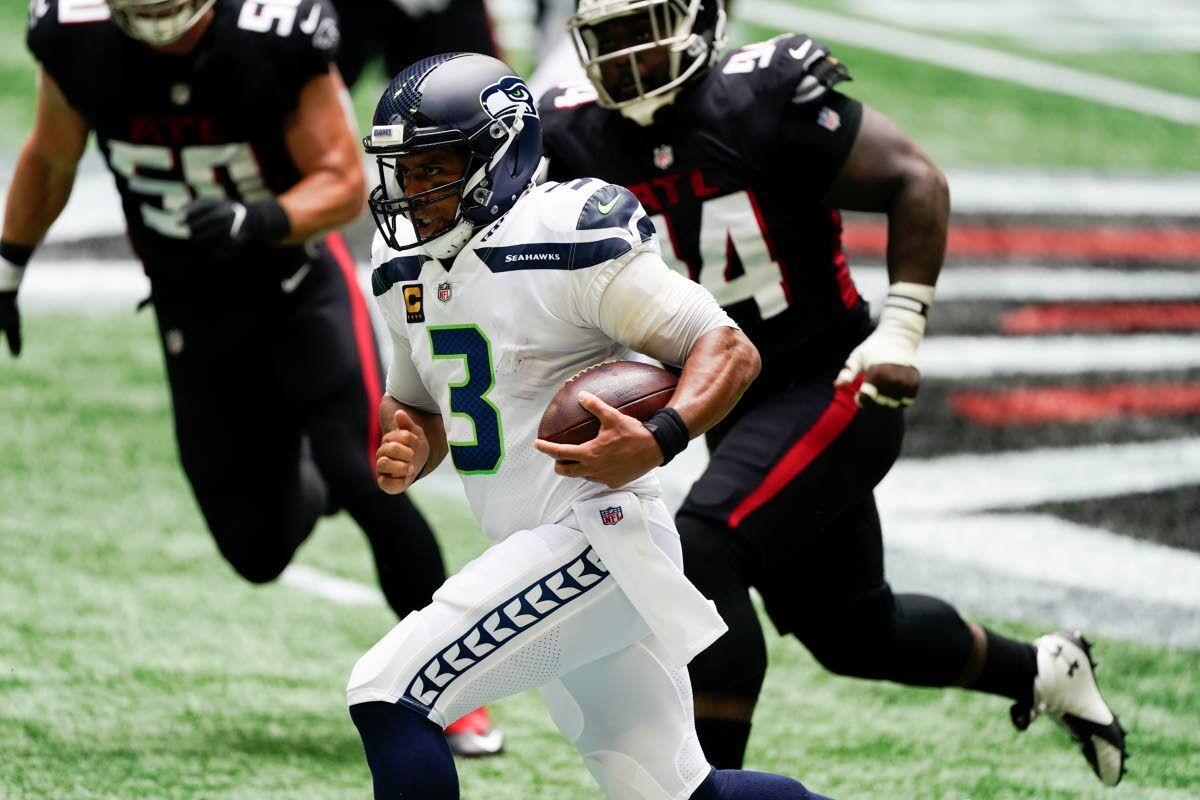Wilson throws 4 TD passes, Seahawks soar in opener