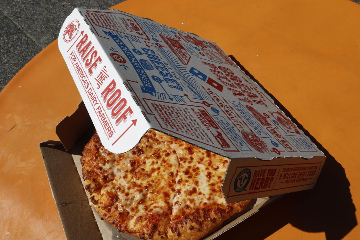 Earns Domino's Pizza