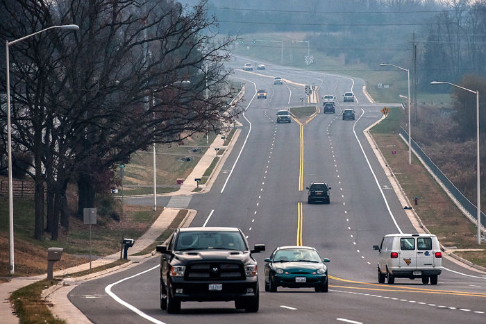 Traffic motors along on Stone Spring Road Wednesday. The Metro Planning Organization will hold an open house to gather public input on its long-range ...