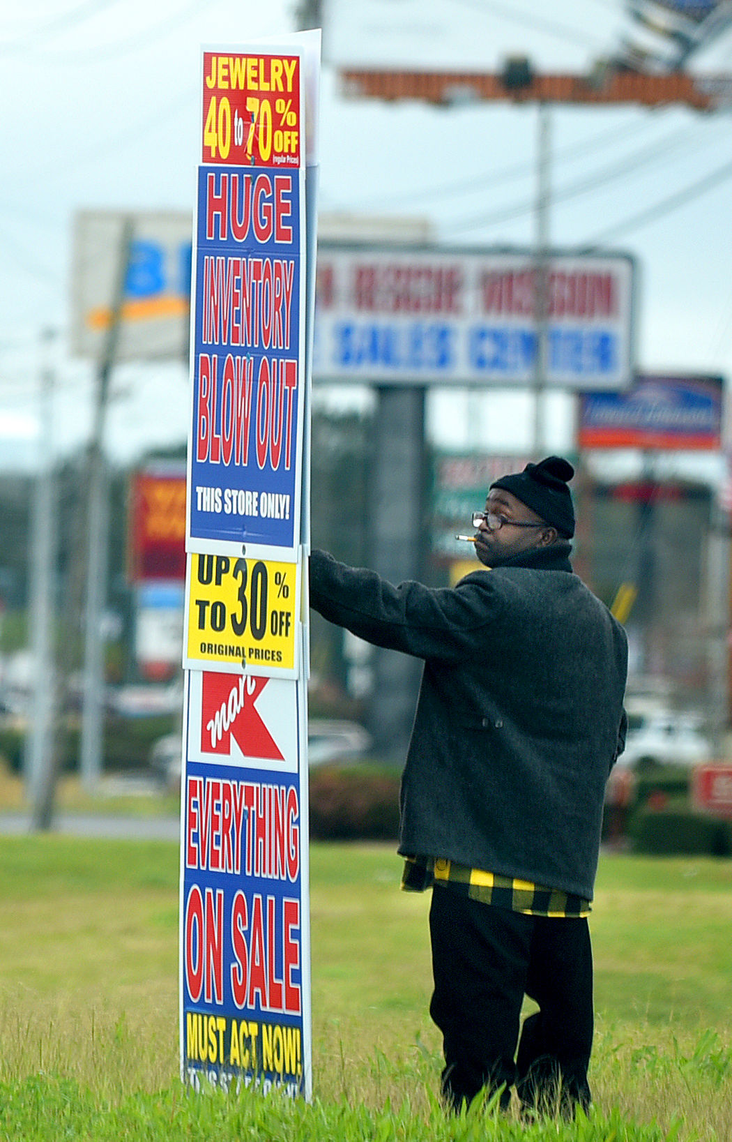 JAY HARE / DOTHAN EAGLE A Man Holds A Promotional Sign For Kmart Next To  The Southside Location On Friday. Kmart Has Confirmed That The Southside  Kmart ...