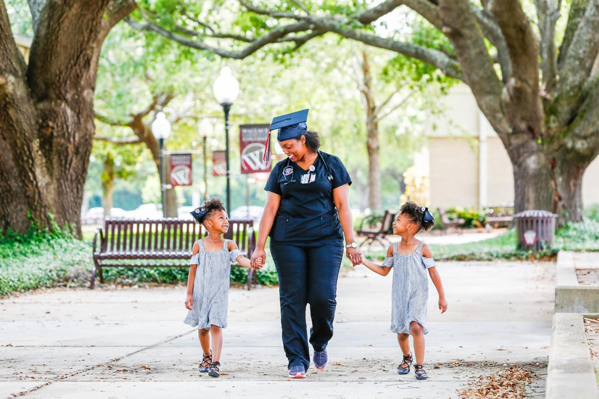 Aliyah Jacobs with twin daughters Ava and Arial Harris