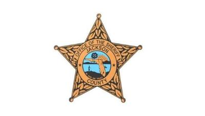Armed man charged with trespassing